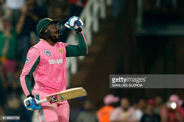 South African batsman Andile Pehlukwayo celebrates after winning the fourth One Day International cricket match between South Africa and India at...