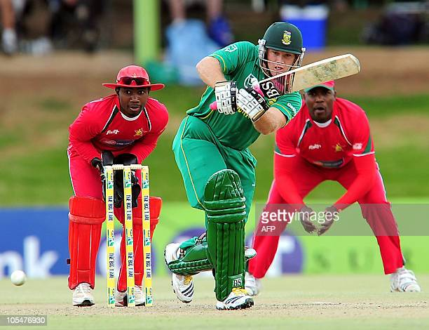 South African batsman Colin Ingram plays a stroke as Zimbabwean wicketkeeper TatendaTaibu watches on October 15 2010 during the One Day international...