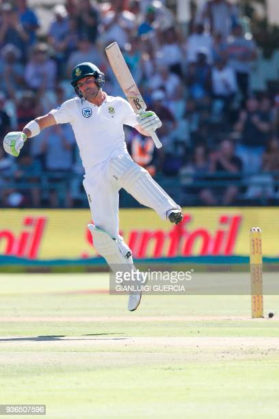 South African batsman Dean Elgar celebrates after scoring a century during the first day of the third Test cricket match between South Africa and...