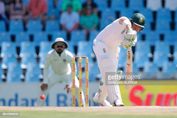 South African batsman Dean Elgar plays a shot during the first day of the second Test cricket match between South Africa and India at Supersport...