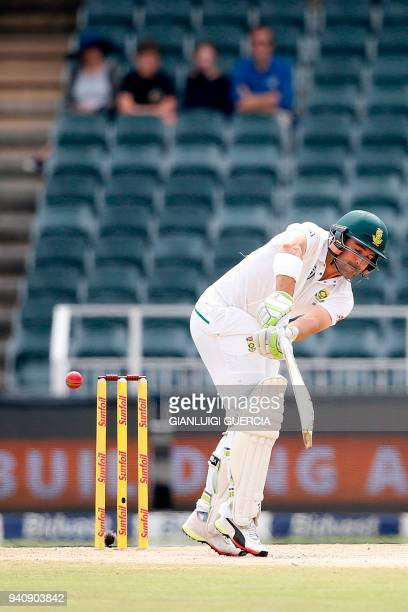 South African batsman Dean Elgar plays a shot on the fourth day of the fourth Test cricket match between South Africa and Australia at Wanderers...