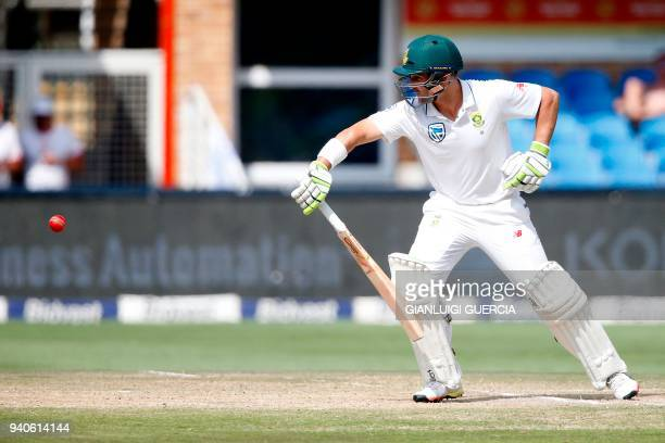 South African batsman Dean Elgar plays a shot on the third day of the fourth Test cricket match between South Africa and Australia won by South...