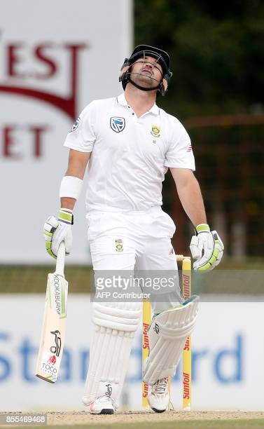 South African batsman Dean Elgar reacts after his dismissal by Bangladesh bowler Mustafizur Rahman during the second day of the first Test cricket...