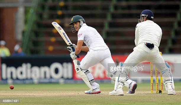 South African batsman Faf du Plessis bats with Indian wicketkeeper Mahendra Singh Dhoni behind on the 5th day of a first cricket Test match between...