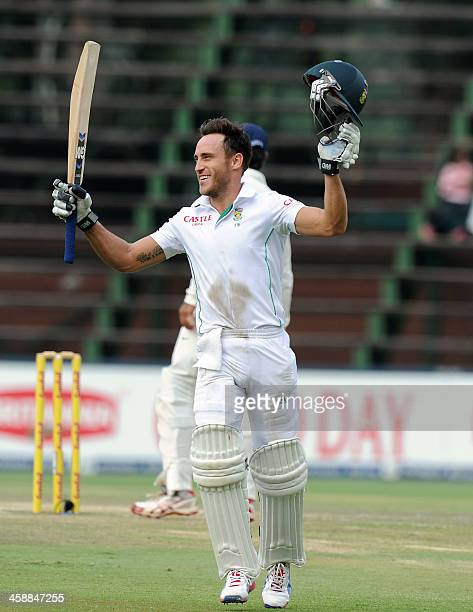 South African batsman Faf du Plessis celebrates his century on the fifth day of a first cricket Test match between South Africa and India in...