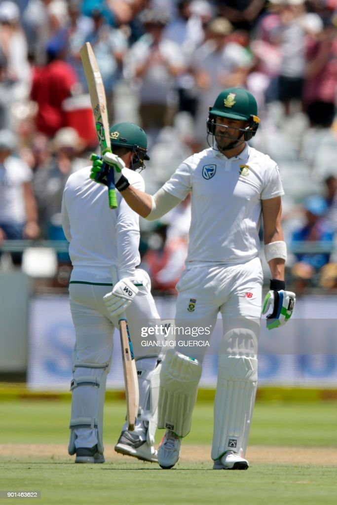 South African batsman Faf du Plessis raises his bat as he celebrates scoring a half century (50 runs) during Day One of the cricket First Test match between South Africa and India in Cape Town, on January 5, 2018. /