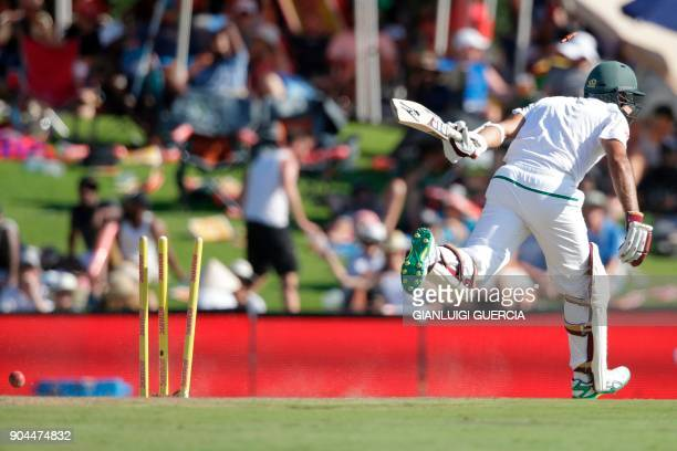 South African batsman Hashim Amla is run out during the first day of the second Test cricket match between South Africa and India at Supersport...
