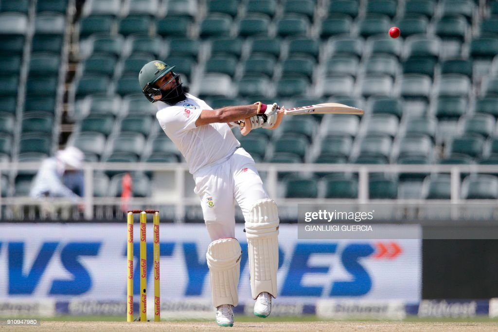 South African batsman Hashim Amla plays a shot during the fourth day of the third test match between South Africa and India at Wanderers cricket ground in Johannesburg on January 27, 2018. /