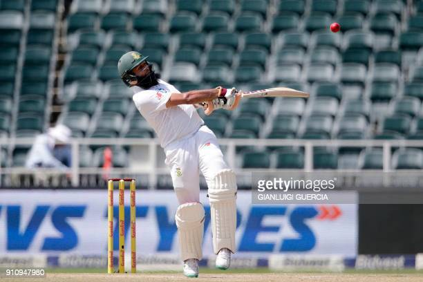 South African batsman Hashim Amla plays a shot during the fourth day of the third test match between South Africa and India at Wanderers cricket...