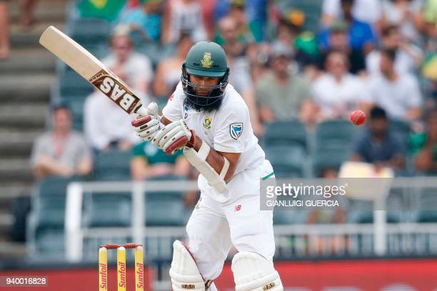 South African batsman Hashim Amla plays a shot on the first day of the fourth Test cricket match between South Africa and Australia at Wanderers...