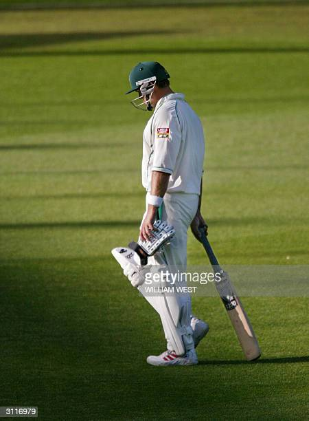 South African batsman Jacques Kallis is dejected as he walks off after been dismissed short of a century that would have given the record with Don...