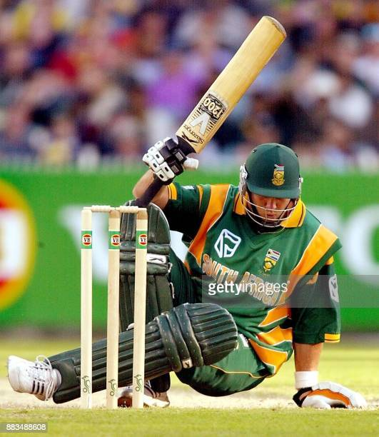 South African batsman Jacques Kallis takes evasive action from a bouncer from Australian paceman Andy Bichel in their one-day match being played at...