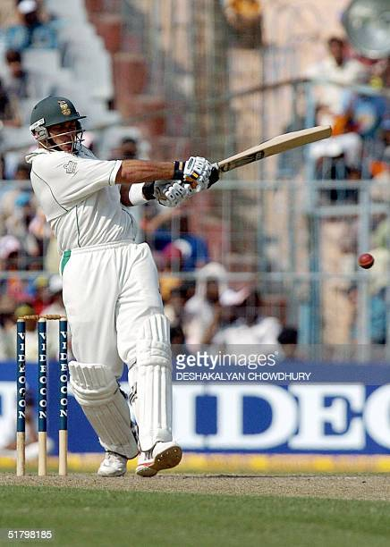 South African batsman Jaques Kallis hits a boundary during the first day of the second and final Test match between India and South Africa at the...