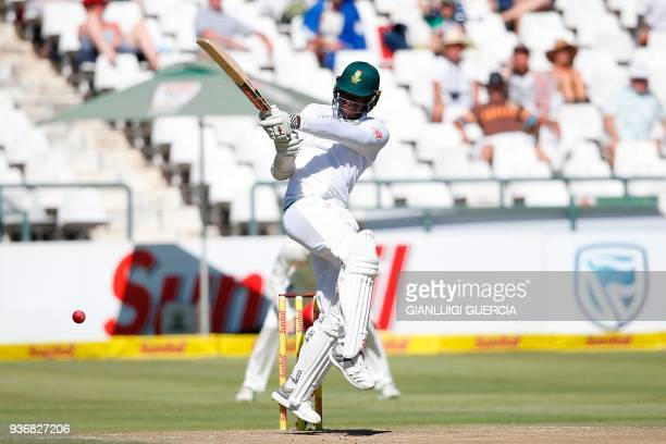 South African batsman Kagiso Rabada plays a shot during the second day of the third Test cricket match between South Africa and Australia at Newlands...