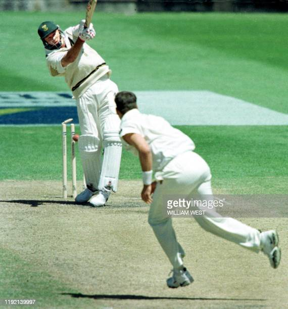 South African batsman Pat Symcox is bowled by Australian fast bowler Michael Kasprowicz for four runs as the South African struggled to be all out...