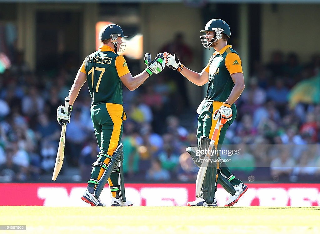 South African batsman Rilee Rossouw congratulates AB De Villiers after scoring 50 during the 2015 ICC Cricket World Cup match between South Africa and the West Indies at Sydney Cricket Ground on February 27, 2015 in Sydney, Australia.