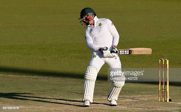 South African batsman Stiaan van Zyl fends off bouncer on the third day of the second Cricket Test Match between South Africa and New Zealand at the...