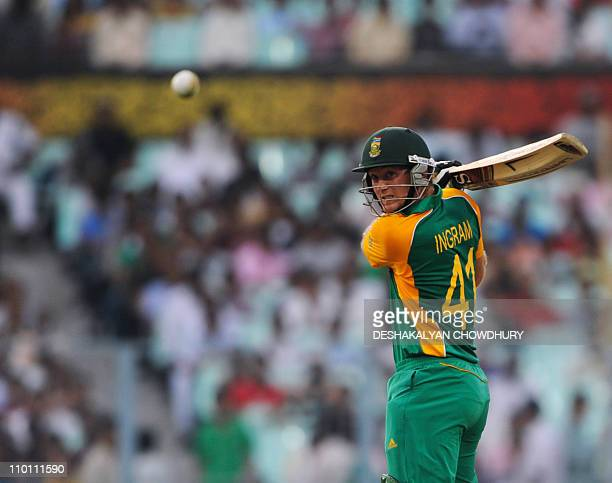 South African batsmen Colin Ingram eyes the ball as he plays a shot during the Group B match 34 in the World Cup Cricket tournament at The Eden...