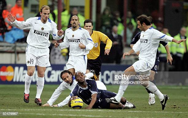 South African Benni McCarthy of FC Porto is tackled by Sinisa Miajlovic and surrounded by a group of Inter Milan players during their Champion's...