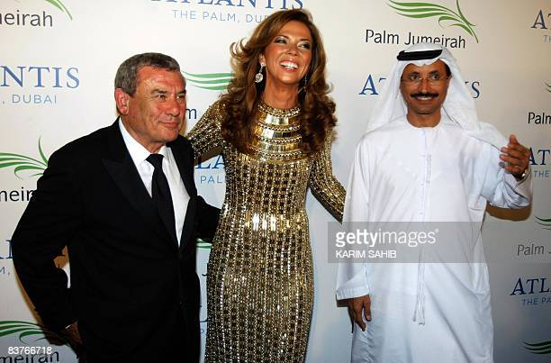 South African billionnaire Sol Kerzner Chairman of Kerzner International stands with his wife Heather Kerzner and Sultan Ahmed bin Sulayem Chairman...
