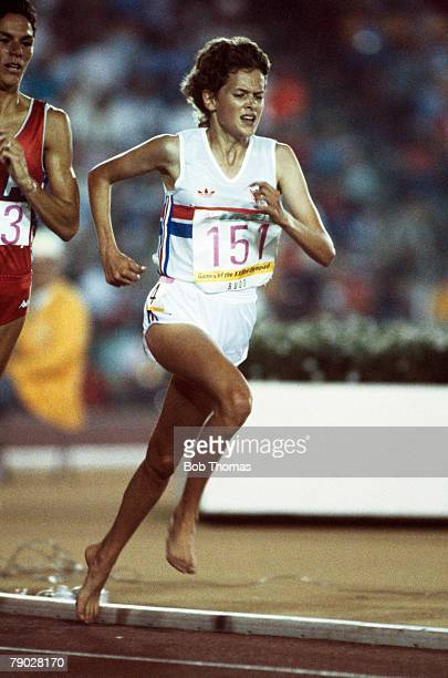 South African born athlete Zola Budd competes for Great Britain as she runs barefoot in the women's 3000 metres event at the 1984 Summer Olympics in...