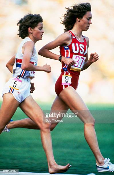 South African born athlete Zola Budd of Great Britain and American athlete Mary Decker compete in the final of the Women's 3000 Metres event at the...