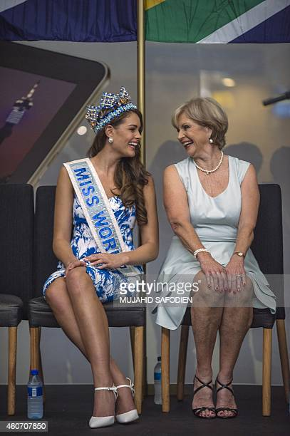 South African born Rolene Strauss , the newly crowned Miss World 2014, speaks to South African 1958 Miss World, Penny Coelen Rey, upon her arrival at...