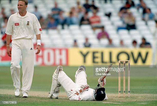 South African bowler Allan Donald floors England batsman Mike Atherton with a bouncer during the 4th Test between England and South Africa at Trent...