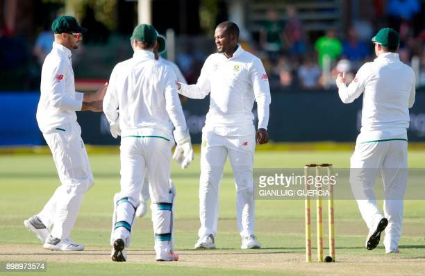 South African bowler Andile Phehlukwayo celebrates the dismissal of Zimbabwean batsman Peter Moor during the second day of the daynight Test cricket...
