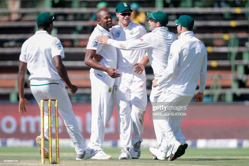 South African bowler Andile Phehlukwayo (2nd L) celebrates the dismissal of Indian batsman Cheteshwar Pujara (not in picture) during the first day of the third test match between South Africa and India at Wanderers cricket ground on January 24, 2018 in Johannesburg. /