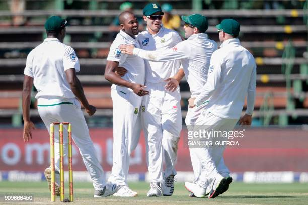 South African bowler Andile Phehlukwayo celebrates the dismissal of Indian batsman Cheteshwar Pujara during the first day of the third test match...