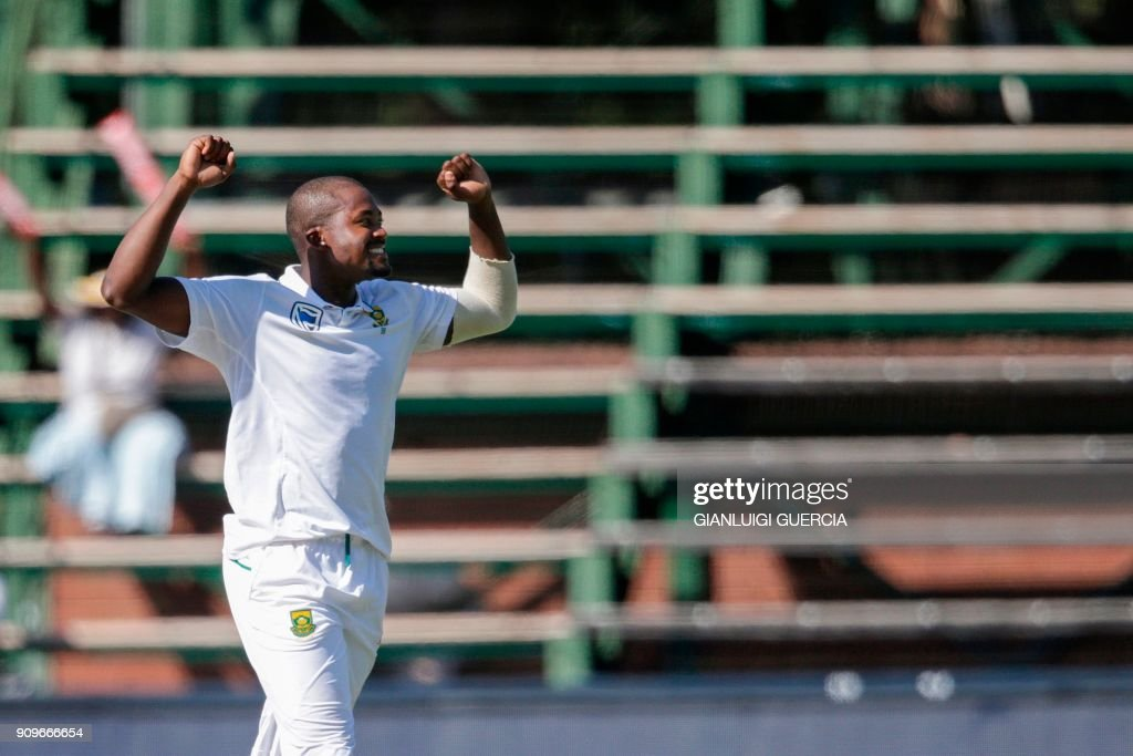 South African bowler Andile Phehlukwayo (L) celebrates the dismissal of Indian batsman Hardik Pandya (not in picture) during the first day of the third test match between South Africa and India at Wanderers cricket ground on January 24, 2018 in Johannesburg. /