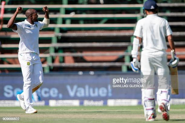 South African bowler Andile Phehlukwayo celebrates the dismissal of Indian batsman Hardik Pandya during the first day of the third test match between...