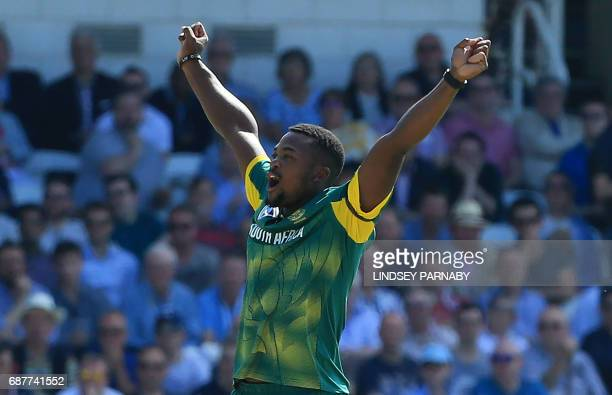South African bowler Andile Phehlukwayo celebrates the wicket of England batsman Joe Root after teammate Ashim Amla caught Root off Phehlikwayo's...