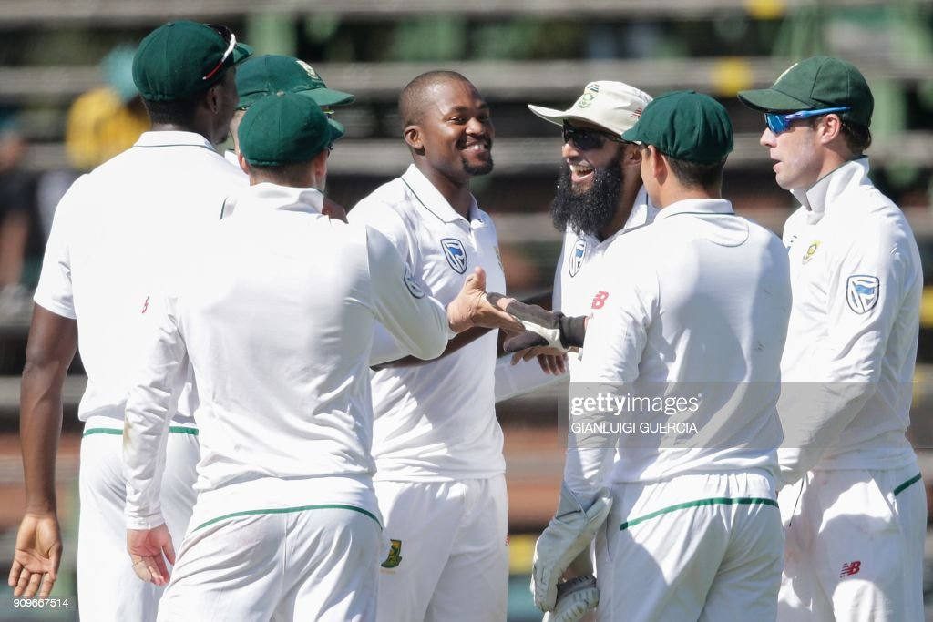 South African bowler Andile Phehlukwayo (C) celebrates with his teammates the dismissal of Indian batsman Cheteshwar Pujara (not in picture) during the first day of the third test match between South Africa and India at Wanderers cricket ground on January 24, 2018 in Johannesburg. /