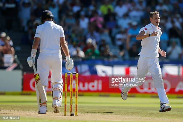 South African bowler Chris Morris celebrates dismissing England batsman Joe Root on the day one of the second test match between South Africa and...