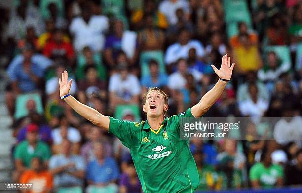 South African bowler Chris Morris celebrates the wicket of New Zealand batsman James Neesham during the T20 cricket match between South Africa and...