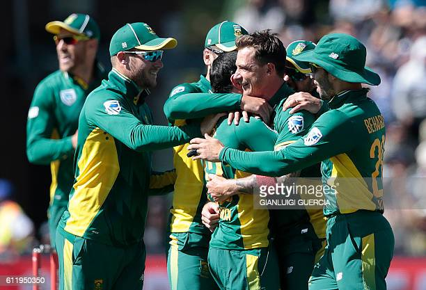 South African bowler Dale Steyn and the South African team celebrates the dismissal of Australian Batsman Steven Smith during the second One Day...