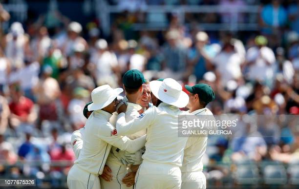 South African bowler Dale Steyn celebrates with teammates after the dismissal of Pakistan batsman Shan Masood during the third day of the second Test...