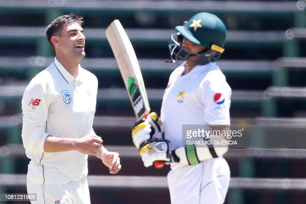 South African bowler Duanne Olivier celebrates next to Pakistan batsman Mohammad Abbas during the second day of the third Cricket Test match between...