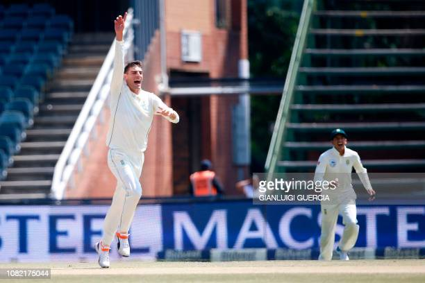 South African bowler Duanne Olivier celebrates the dismissal of Pakistan batsman Babar Azam during the fourth day of the third Cricket Test match...