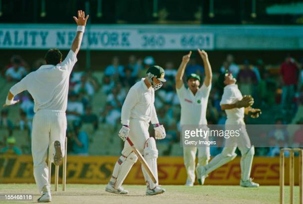 South African bowler Fanie de Villiers celebrates taking the wicket of Mark Taylor during Australia's second innings during the 2nd Test against at...