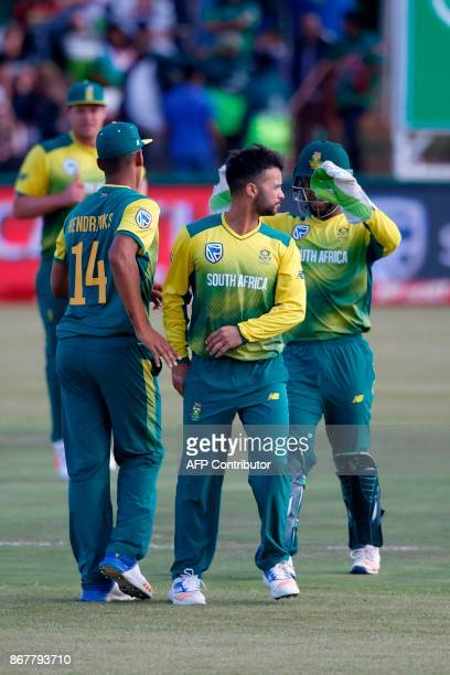 South African bowler JP Duminy celebrates the dismissal of Bangladesh batsman Sabbir Rahman during the second T20 cricket match between South Africa...