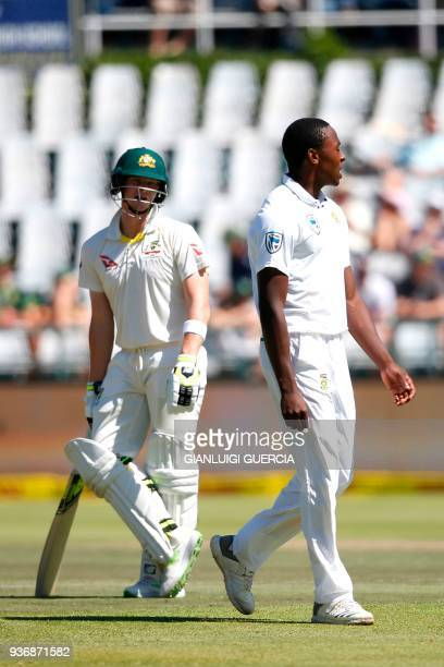 South African bowler Kagiso Rabada and Australian batsman Steven Smith interact during the second day of the third Test cricket match between South...