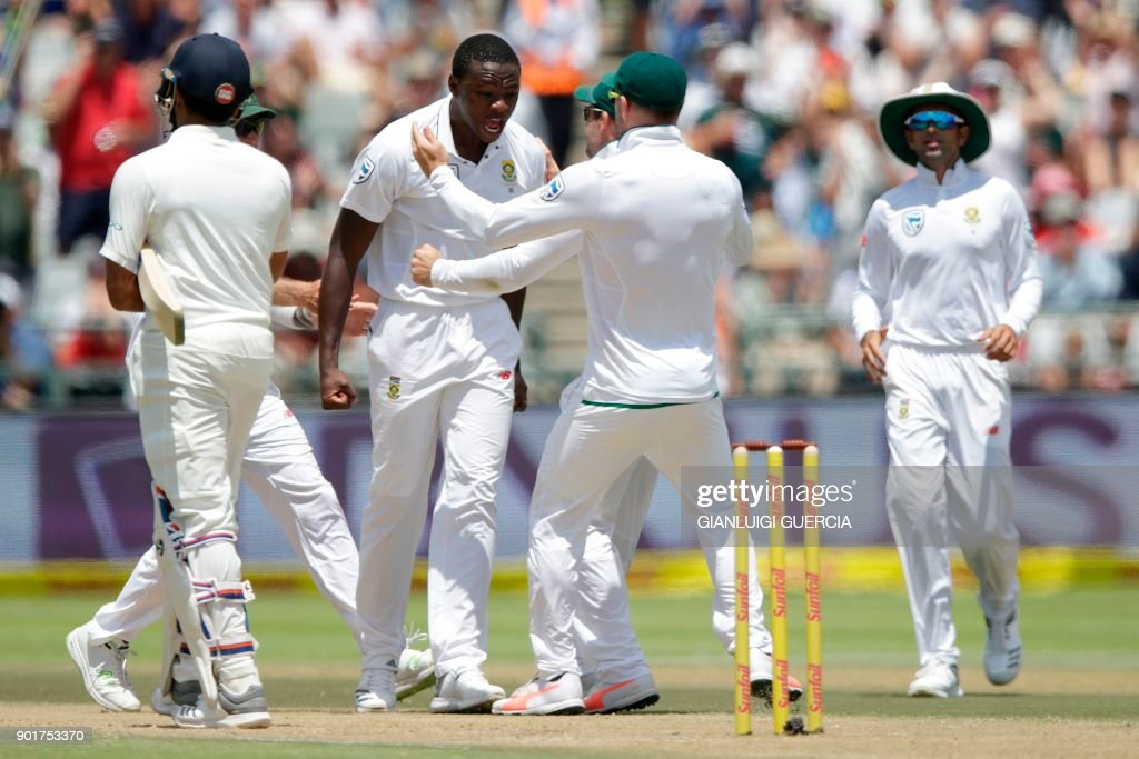 South African bowler Kagiso Rabada (C) celebrates the dismissal of Indian batsman Rohit Sharma (L) during the second day of the first Test cricket match between South Africa and India at Newlands cricket ground on January 6, 2018 in Cape Town, South Africa. /