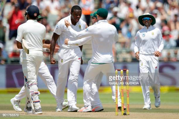 South African bowler Kagiso Rabada celebrates the dismissal of Indian batsman Rohit Sharma during the second day of the first Test cricket match...