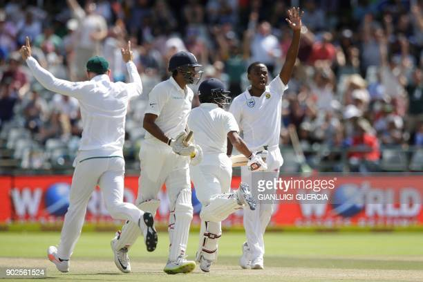 South African bowler Kagiso Rabada celebrates the dismissal of Indian batsman Wriddhiman Saha during the fourth day of the First Test cricket match...