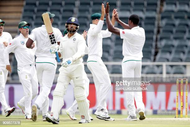 South African bowler Kagiso Rabada celebrates the dismissal of Indian batsman Murali Vijay during the first day of the third test match between South...