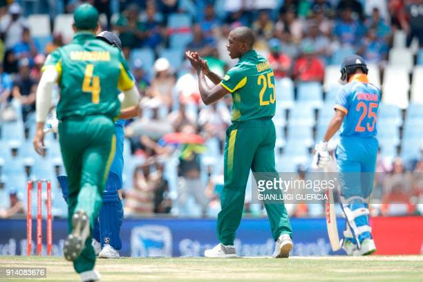 South African bowler Kagiso Rabada celebrates the dismissal of Indian batsman Rohit Sharma during the second One Day International cricket match...
