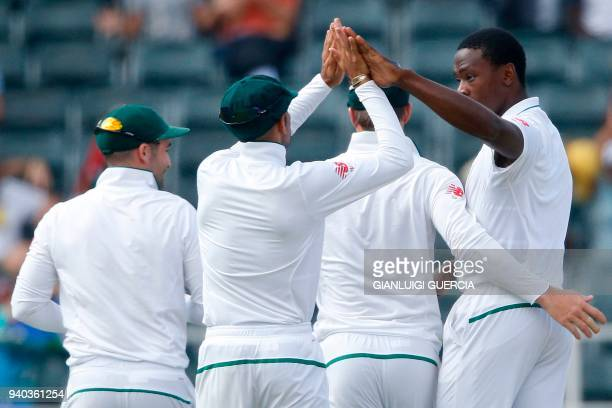 South African bowler Kagiso Rabada celebrates the dismissal of Australian batsman Joe Burns on the second day of the fourth Test cricket match...